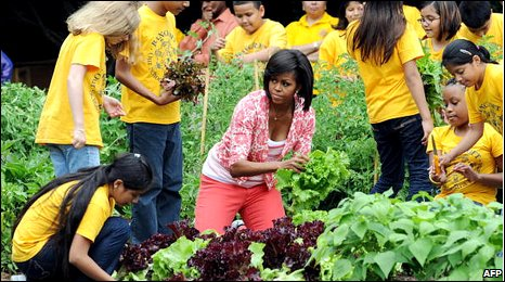 Michelle Obama planting vegtables with local school children, the White House garden, June 2009