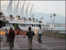 People walking past Canada Place in Vancouver