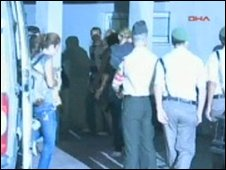 TV footage of women arriving at police station