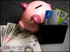 Piggy bank, notes and credit cards