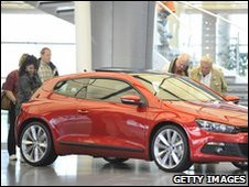 People checking out VW Scirocco in Autostadt amusement park