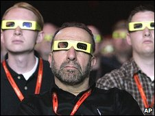People watch a high-definition 3-D / 3D presentation