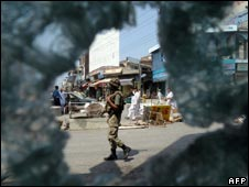 A Pakistani soldier patrols Mingora, the main town of Swat valley, on August 1, 2009