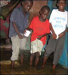 Mamadou Mbaye's children in their flooded house