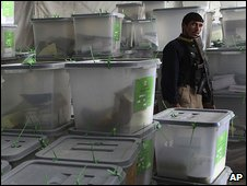 A guard stands by ballot boxes at the Independent Election Commission