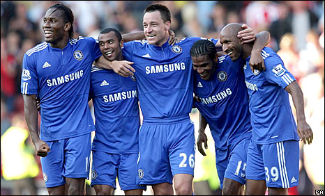 Chelsea celebrate Florent Malouda's winning goal