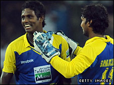 Angelo Mathews (left) is congratulated by captain Kumar Sangakkara