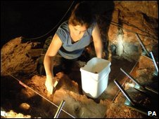 Sheffield archaeology student Iona Chaddock excavating at Kents Cavern