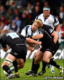 Sale's Matthew Tait is tackled by James Hudson