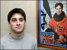 Assaf Ramon and a portrait of his late astronaut father, in 2004