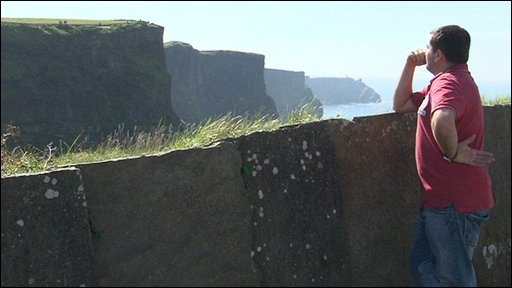 Man looking out over cliffs