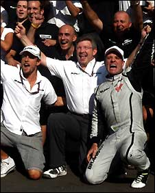 Jenson Button, Ross Brawn and Rubens Barrichello celebrate their Monza one-two