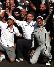 Jenson Button, Ross Brawn and Rubens Barrichello celebrate their Monza one-two
