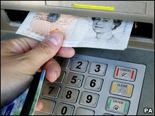 £10 being withdrawn from cash machine