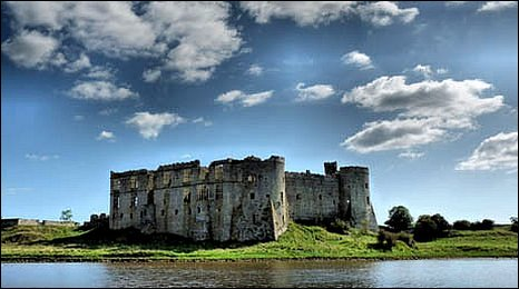 Image showing the exterior of the castle with blue skies and the water in front of it