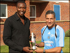 Newcastle striker Shola Ameobi and caretaker manager Chris Hughton