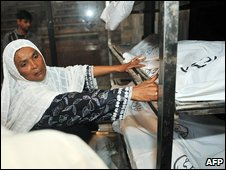 A woman searches for a relative's body in Karachi following a stampede, 14 September 2009