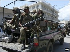 Pakistan Army soldiers patrol in Kanju, near Mingora, capital of Pakistani troubled Valley of Swat, Tuesday, Sept. 1, 2009