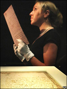 Virginia Barnes holds a replica of the last letter by Mary Queen of Scots, with the genuine letter in a display cabinet