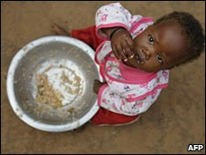 A Somali child eats near Mogadishu. Photo: August 2009