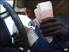 bus driver collecting fares