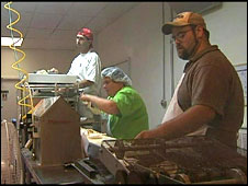 Workers at the Armstrong Pie Company, which has expanded its workforce after receiving government backing