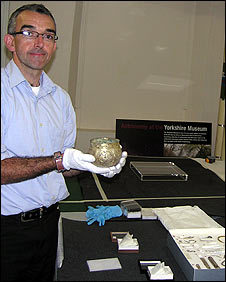 Andrew Morrison holds the silver-gilt cup in which the hoard was packed.