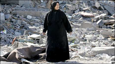A Palestinian walks amidst the debris of destroyed buildings following Israeli air strikes in Rafah, Gaza. Photo: January 2009