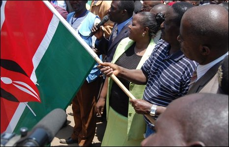Kenyan Prime Minister Raila Odinga waving a Kenya flag