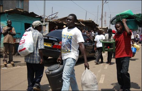 Streets near Kibera with people carrying their belongings