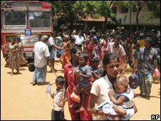 Sri Lankan Tamils in displacement camps look for transport to get back to their villages after being released by the authorities in Vavuniya on Sept 11, 2009