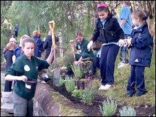 Children planting bumblebee garden