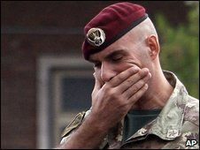 An Italian army officer reacts to the news at a barracks in Siena, Italy