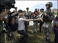 Journalists interview Chinese soldiers at a military camp - 10 September 2009