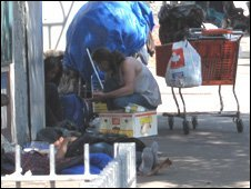 Homeless people on the pavement.