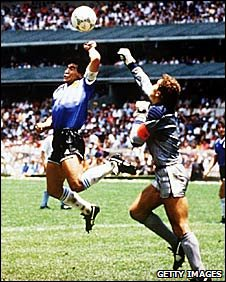Argentina's Maradona outjumps England keeper Peter Shilton to score in the 1986 World Cup quarter-final