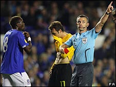 Louis Saha (left) reacts in dismay as he is sent off in stoppage time