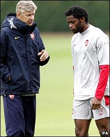 Arsene Wenger (left) and Alex Song