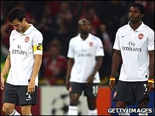 Arsenal's players are dejected after going 2-0 down in Liege