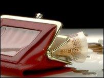 An open purse containing money