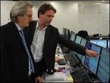 Paul Lewis and economist Don Smith look at swap rates on a computer screen