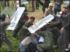 Demonstrators from the People's Alliance for Democracy clash with police and local villagers near Sisaket