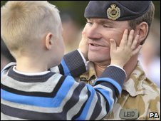 Young Cameron Leid welcomes home his dad, Sgt Leid