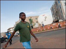 Boy walks on the street, Kigali