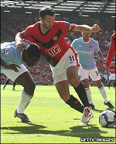 Ryan Giggs (right) holds off Micah Richards