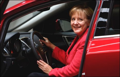 Angela Merkel sits inside a Opel Astra car at the during Frankfurt's international motor show on 17 September 2009
