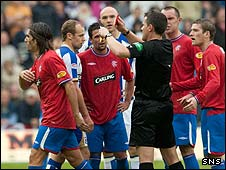 Steve Conroy shows Pedro Mendes a red card