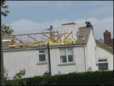 Builder demolishes roof