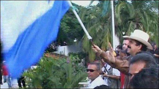 Manuel Zelaya waving a flag