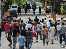 Supporters of deposed Honduran President Manuel Zelaya confront the police at Hato de Enmedio neigborhood in Tegucigalpa, Honduras on Tuesday
